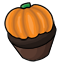 A chocolate cupcake topped with a sugary pumpkin.