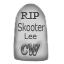 A commemorative stuffed gravestone to Skooter Lee.
